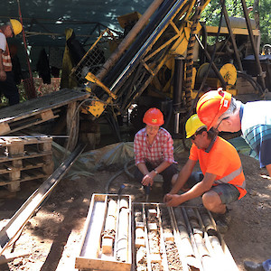 Examining some of the first drill core from the project